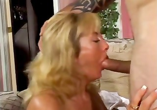 Mature plump blonde nibbles on his young boner