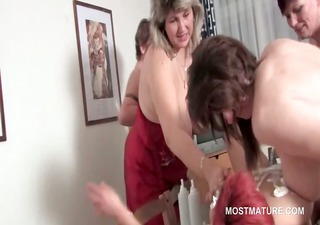 Orgy lesbo matures lick pussy and fuck strap-on