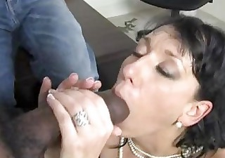 Randy brunette momma with huge hooter sucks big