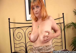 Redheaded granny with large titties sucks strapon